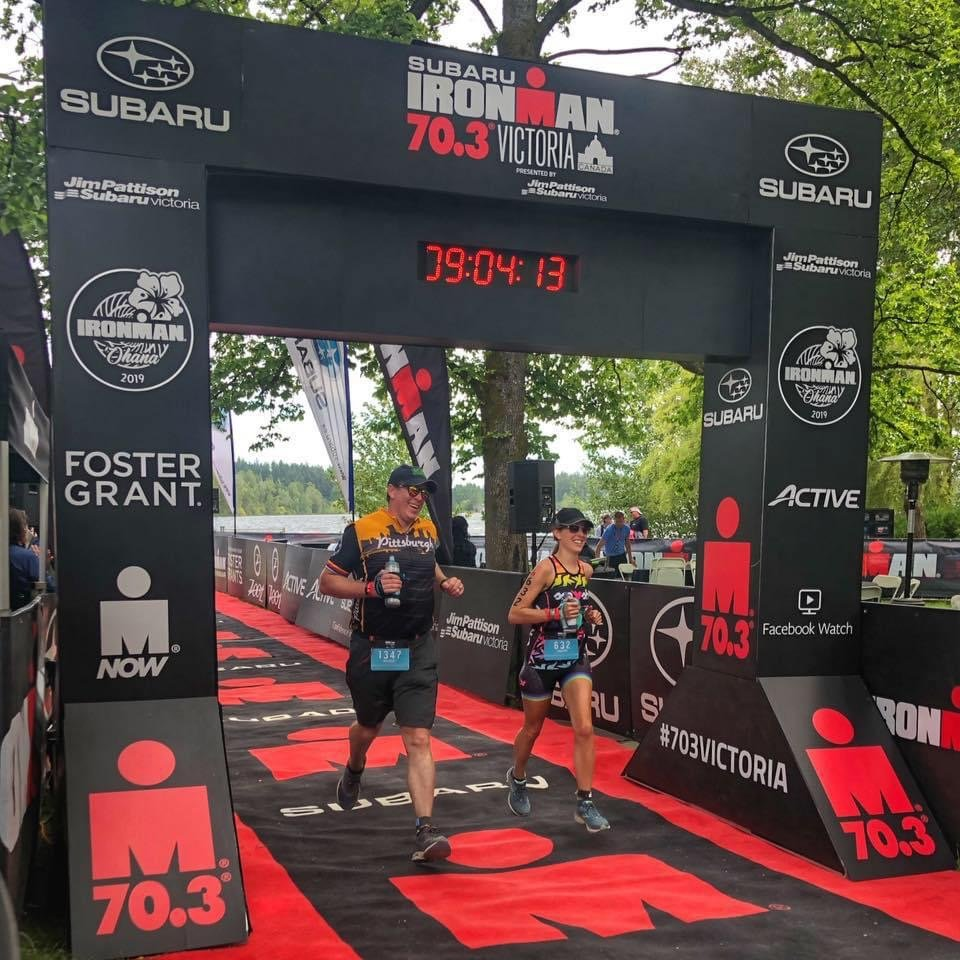 Dr. Zetwo and her husband crossing the finish link of an IronMan race